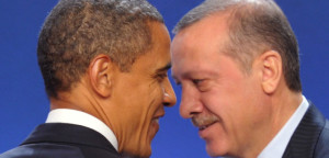 U.S. President Obama and Turkey's Prime Minister Erdogan take part in a family photo during the G20 Summit in Cannes