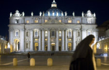 A Roman Catholic nuns strolls past Saint Peter's Basilica at the Vatican February 9, 2009. Eluana Englaro, the 38-year-old comatose woman at the centre of an Italian right-to-die case, died on Monday night despite efforts by Prime Minister Silvio Berlusconi to order doctors to feed her, the clinic said. The case led to a constitutional crisis pitting Berlusconi against the head of state and provoked a debate about whether the Vatican, by siding openly with Berlusconi, was unduly interfering.  REUTERS/Chris Helgren        (VATICAN)
