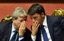 Italian Prime Minister Matteo Renzi (R) speaks with Foreign Affairs Minister Paolo Gentiloni after his speech focused on the next European Council, on October 14, 2015 at the Senate in Rome.  AFP PHOTO / ALBERTO PIZZOLI        (Photo credit should read ALBERTO PIZZOLI/AFP/Getty Images)