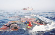 epa06896388 A handout photo made available by Spanish NGO 'Proactiva Open Arms' on 18 July 2018 shows of a body (L)  among a shipwreck in which a surviving Cameroonian woman (C) is found and rescued, in the Mediterranean, 17 July 2018. Proactiva Open Arms's ship 'Astral' rescued the woman from the Mediterranean Sea a day before. The woman was found next to the bodies of an other woman and a little child.  EPA/Proactiva Open Arms / HANDOUT  HANDOUT EDITORIAL USE ONLY/NO SALES