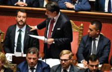 Italian Prime Minister Giuseppe Conte (C) is flanked by Deputy Prime Ministers Matteo Salvini (L) and Luigi Di Maio (R) as he addresses to the Senate about the government crisis, in Rome, Italy, 20 August 2019. ANSA/ ETTORE FERRARI